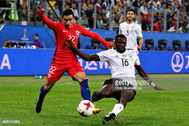 Antonio Ruediger of Germany tackles Edson Puch of Chile during the FIFA Confederations Cup Russia 2017 Final match between Chile and Germany at Saint...