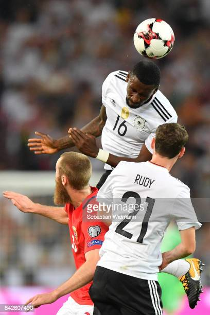 Antonio Ruediger of Germany with Jorgen Skjelvik of Norway and Sebastian Rudy of Germany during the FIFA 2018 World Cup Qualifier between Germany and...
