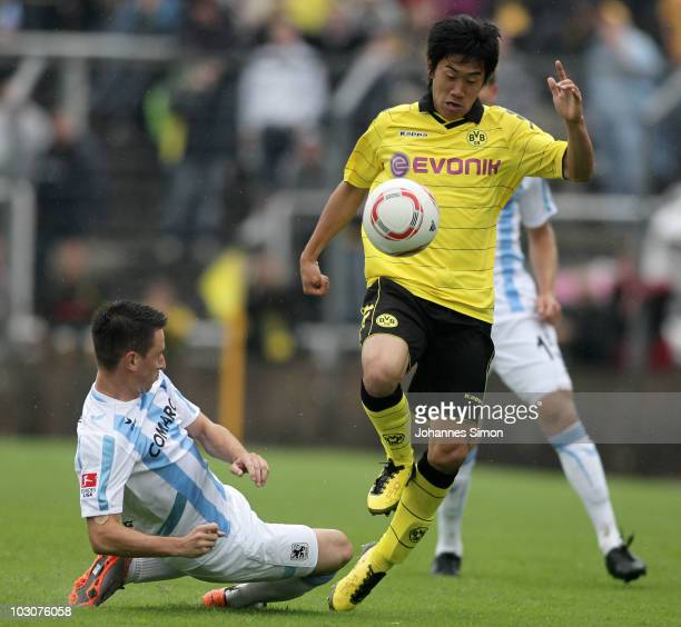 Antonio Rukavina of Muenchen and Shinji Kagawa of Dortmund fight for the ball during the preseason friendly match 1860 Muenchen v Borussia Dortmund...