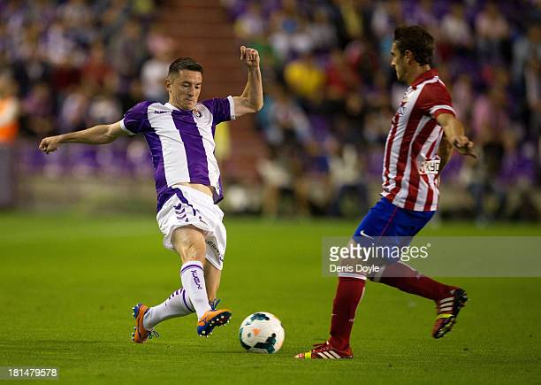 Antonio Rukavina of Real Valladolid CF battles for the ball with Koke of Club Atletico de Madrid during the La Liga match between Real Valladolid CF...