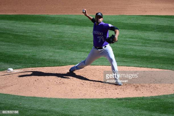 Antonio Senzatela of the Colorado Rockies delivers a pitch during the spring training game against the Arizona Diamondbacks at Salt River Fields at...
