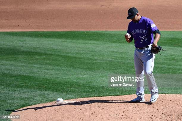 Antonio Senzatela of the Colorado Rockies prepares to deliver a pitch during the spring training game against the Arizona Diamondbacks at Salt River...