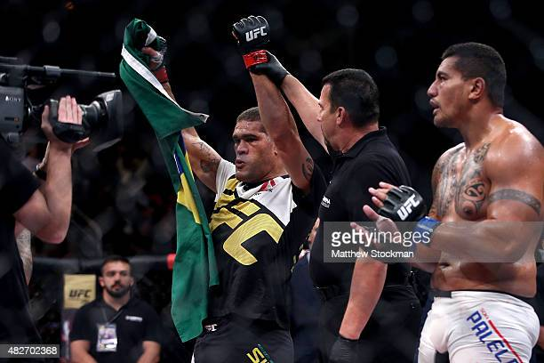 Antonio Silva of Brazil celebrates his win over Soa Palelei of Australia in their heavyweight bout during the UFC 190 Rousey v Correia at HSBC Arena...
