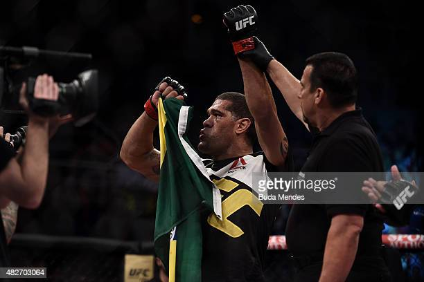 Antonio Silva of Brazil celebrates victory over Soa Palelei of Australia in their heavyweight bout during the UFC 190 Rousey v Correia at HSBC Arena...