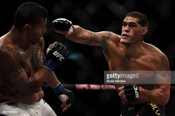 Antonio Silva of Brazil punches Soa Palelei of Australia in their heavyweight bout during the UFC 190 Rousey v Correia at HSBC Arena> on August 1...