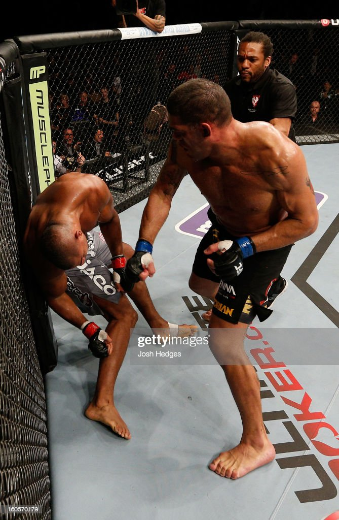 Antonio Silva punches <a gi-track='captionPersonalityLinkClicked' href=/galleries/search?phrase=Alistair+Overeem&family=editorial&specificpeople=7480034 ng-click='$event.stopPropagation()'>Alistair Overeem</a> during their heavyweight fight at UFC 156 on February 2, 2013 at the Mandalay Bay Events Center in Las Vegas, Nevada.