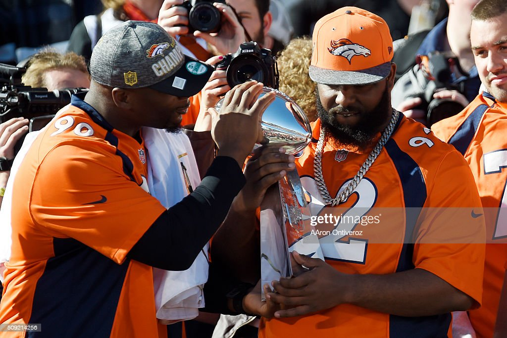 Antonio Smith (left) and Sylvester Williams hold the Super Bowl trophy on the City and County Building steps during the Denver Broncos Super Bowl championship celebration and parade on Tuesday February 9, 2016.