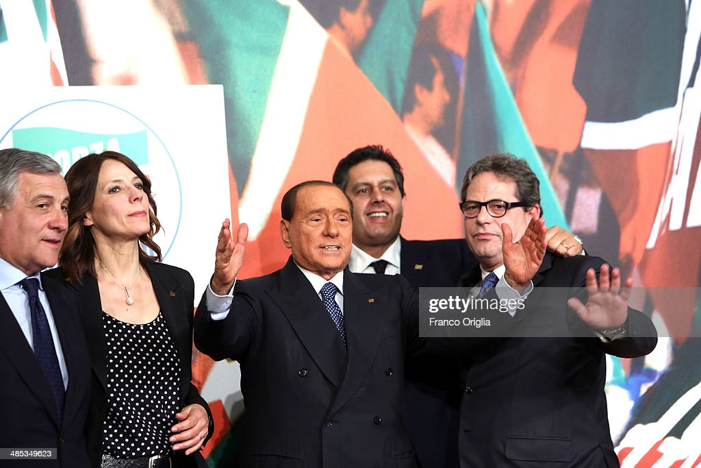 <a gi-track='captionPersonalityLinkClicked' href=/galleries/search?phrase=Antonio+Tajani&family=editorial&specificpeople=5429212 ng-click='$event.stopPropagation()'>Antonio Tajani</a>, Elisabetta Gardini, <a gi-track='captionPersonalityLinkClicked' href=/galleries/search?phrase=Silvio+Berlusconi&family=editorial&specificpeople=201842 ng-click='$event.stopPropagation()'>Silvio Berlusconi</a>, Giovanni Toti and Gianfranco Micciche attend a press conference to open the European electoral campaign of Berlusconi's party Forza Italia at the Forza Italia headquarters on April 17, 2014 in Rome, Italy. Berlusconi is not able to be a candidate himself due to legal issues, after he was sentenced to community service for tax fraud.