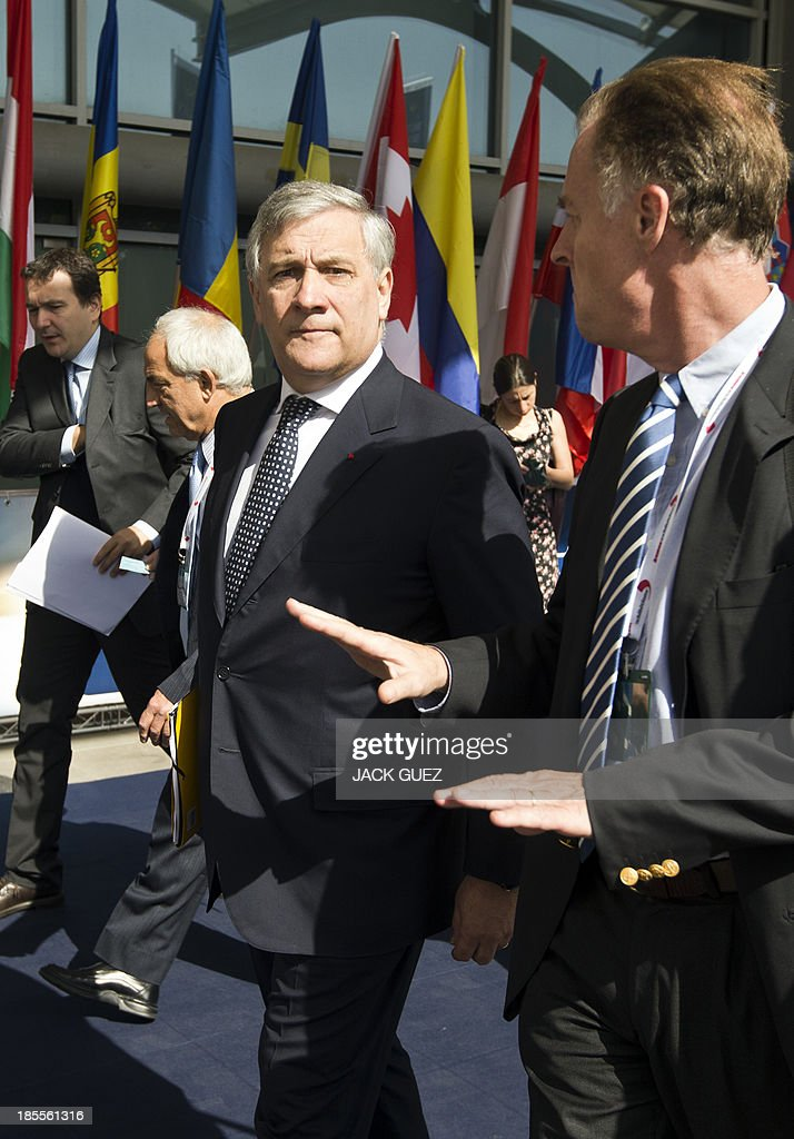 Antonio Tajani (C), vice President and Commissioner for Industry and Entrepreneurship of the European Commission, arrives at the WATEC Water Technology Exhibition in the Mediterranean coastal city of Tel Aviv, on October 22, 2013.