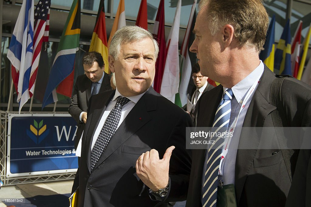 Antonio Tajani (L), vice President and Commissioner for Industry and Entrepreneurship of the European Commission, arrives at the WATEC Water Technology Exhibition in the Mediterranean coastal city of Tel Aviv, on October 22, 2013.