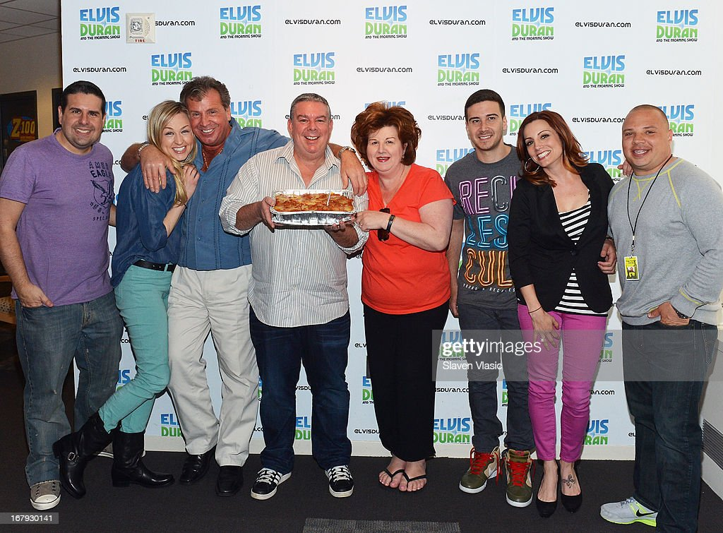 Antonio 'Uncle Nino' Giaimo (3rd L), <a gi-track='captionPersonalityLinkClicked' href=/galleries/search?phrase=Elvis+Duran&family=editorial&specificpeople=3048281 ng-click='$event.stopPropagation()'>Elvis Duran</a> (4th L), Paola Giaimo (5th L), Vincent 'Vinny' Guadagnino (6th L) and <a gi-track='captionPersonalityLinkClicked' href=/galleries/search?phrase=Elvis+Duran&family=editorial&specificpeople=3048281 ng-click='$event.stopPropagation()'>Elvis Duran</a> Z100 Morning Show crew pose for photo at <a gi-track='captionPersonalityLinkClicked' href=/galleries/search?phrase=Elvis+Duran&family=editorial&specificpeople=3048281 ng-click='$event.stopPropagation()'>Elvis Duran</a> Z100 Morning Show at Z100 Studio on May 2, 2013 in New York City.