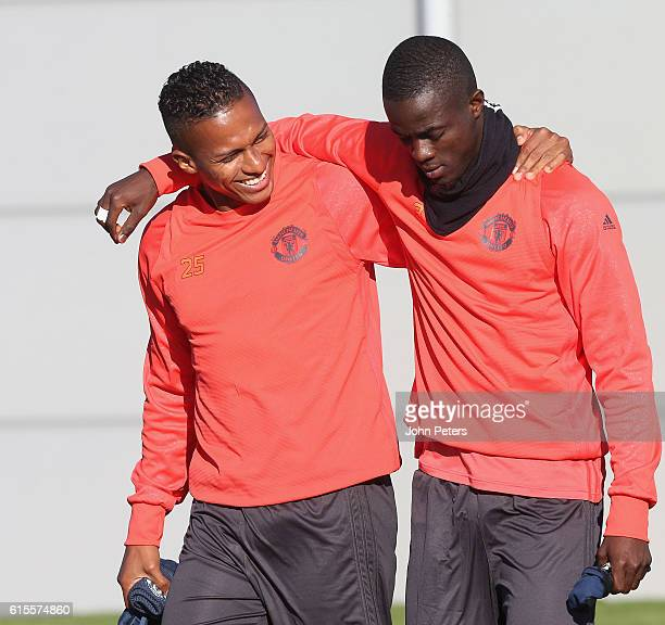 Antonio Valencia and Eric Bailly of Manchester United walk out ahead of a first team training session at Aon Training Complex on October 19 2016 in...
