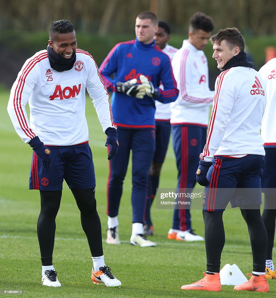 <a gi-track='captionPersonalityLinkClicked' href=/galleries/search?phrase=Antonio+Valencia&family=editorial&specificpeople=543830 ng-click='$event.stopPropagation()'>Antonio Valencia</a> and <a gi-track='captionPersonalityLinkClicked' href=/galleries/search?phrase=Guillermo+Varela&family=editorial&specificpeople=10113482 ng-click='$event.stopPropagation()'>Guillermo Varela</a> of Manchester United in action during a first team training session at Aon Training Complex on April 8, 2016 in Manchester, England.
