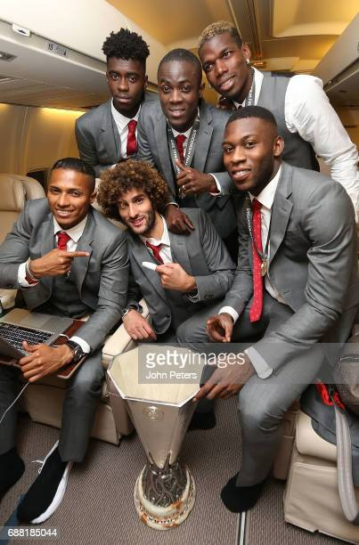 Antonio Valencia Axel Tuanzebe Marouane Fellaini Eric Bailly Paul Pogba and Timothy FosuMensah of Manchester United celebrate with the Europa League...