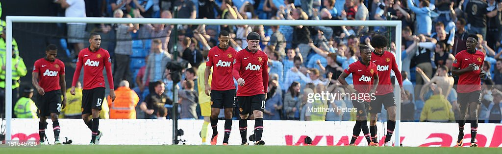 Antonio Valencia, Chris Smalling, Rio Ferdinand, Wayne Rooney, Patrice Evra, Marouace Fellaini and Danny Welbeck of Manchester United react to conceding a goal during the Barclays Premier League match between Manchester City and Manchester United at the Etihad Stadium on September 22, 2013 in Manchester, England.
