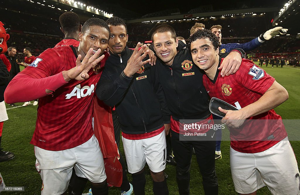 <a gi-track='captionPersonalityLinkClicked' href=/galleries/search?phrase=Antonio+Valencia&family=editorial&specificpeople=543830 ng-click='$event.stopPropagation()'>Antonio Valencia</a>, Nani, Javier 'Chicharito' Hernandez and Rafael da Silva of Manchester United celebrate on the pitch after the Barclays Premier League match between Manchester United and Aston Villa at Old Trafford on April 22, 2013 in Manchester, England.