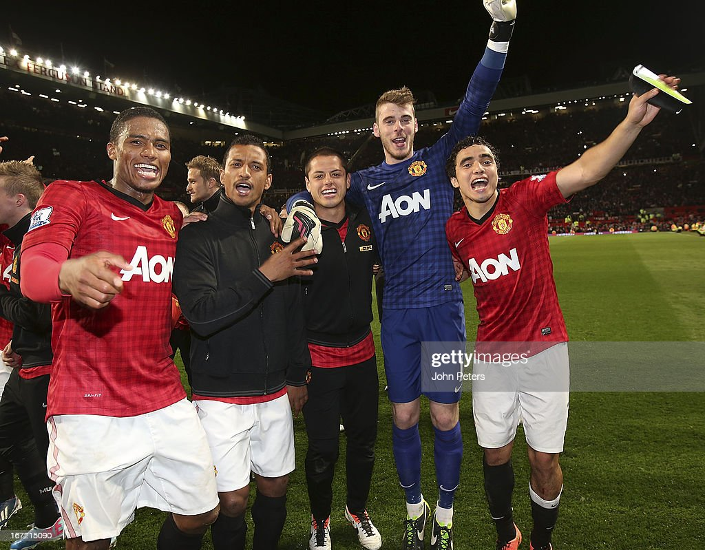 <a gi-track='captionPersonalityLinkClicked' href=/galleries/search?phrase=Antonio+Valencia&family=editorial&specificpeople=543830 ng-click='$event.stopPropagation()'>Antonio Valencia</a>, Nani, Javier 'Chicharito' Hernandez, <a gi-track='captionPersonalityLinkClicked' href=/galleries/search?phrase=David+de+Gea&family=editorial&specificpeople=3000749 ng-click='$event.stopPropagation()'>David de Gea</a> and Rafael da Silva of Manchester United celebrate on the pitch after the Barclays Premier League match between Manchester United and Aston Villa at Old Trafford on April 22, 2013 in Manchester, England.