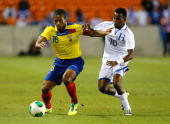Antonio Valencia of Ecuador against Marvin Chavez of Honduras during an international friendly match at BBVA Compass Stadium on November 19 2013 in...