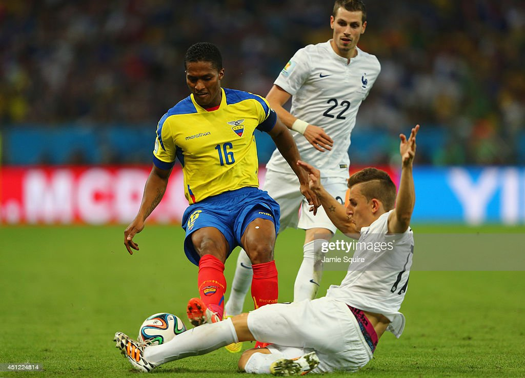 Antonio Valencia of Ecuador challenges Lucas Digne of France during the 2014 FIFA World Cup Brazil Group E match between Ecuador and France at Maracana on June 25, 2014 in Rio de Janeiro, Brazil. Valencia was sent off with a red card for the foul.