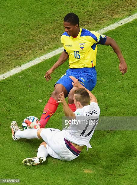Antonio Valencia of Ecuador challenges Lucas Digne of France during the 2014 FIFA World Cup Brazil Group E match between Ecuador and France at...