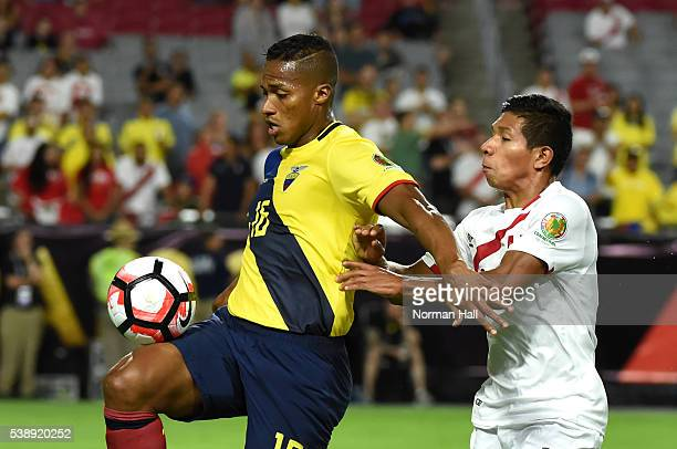 Antonio Valencia of Ecuador fights for the ball with Edison Flores of Peru during a group B match between Ecuador and Peru as part of Copa America...