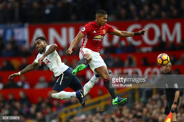 Antonio Valencia of Manchester United and Danny Rose of Tottenham Hotspur compete for the ball during the Premier League match between Manchester...