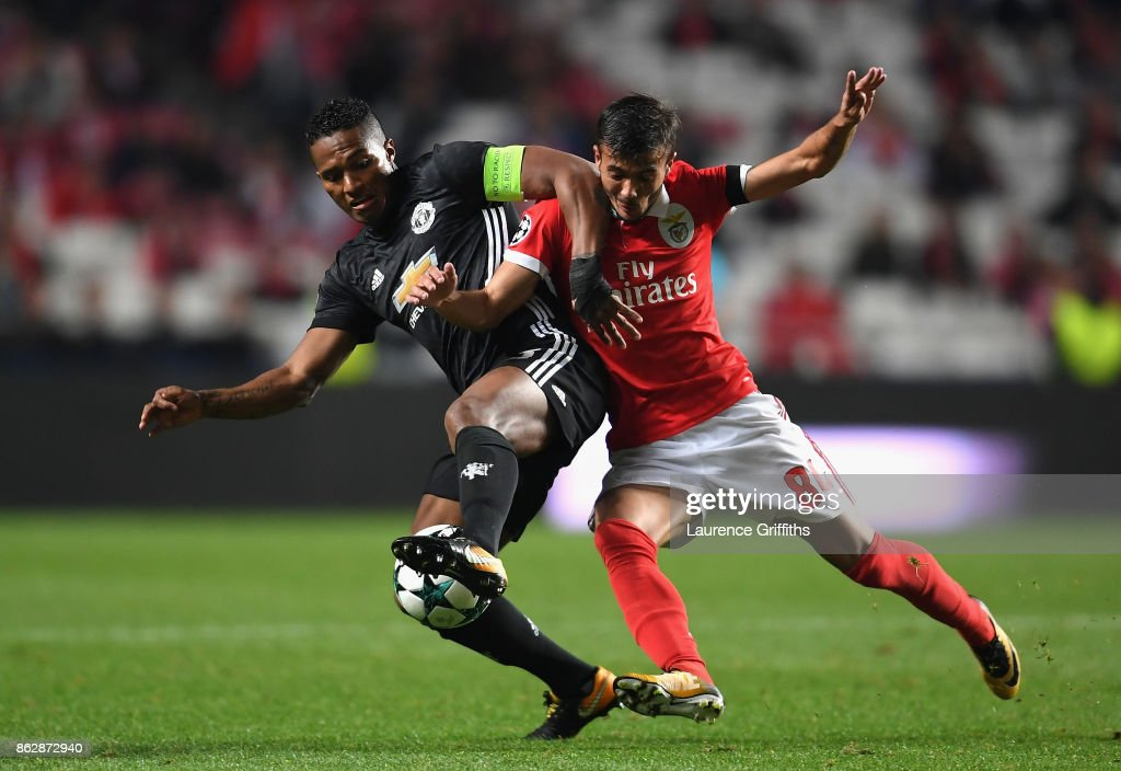 Antonio Valencia of Manchester United and Diogo Antonio Cupido Goncalves of Benfica battle for possession during the UEFA Champions League group A match between SL Benfica and Manchester United at Estadio da Luz on October 18, 2017 in Lisbon, Portugal.