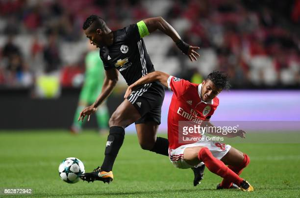 Antonio Valencia of Manchester United and Diogo Antonio Cupido Goncalves of Benfica battle for possession during the UEFA Champions League group A...