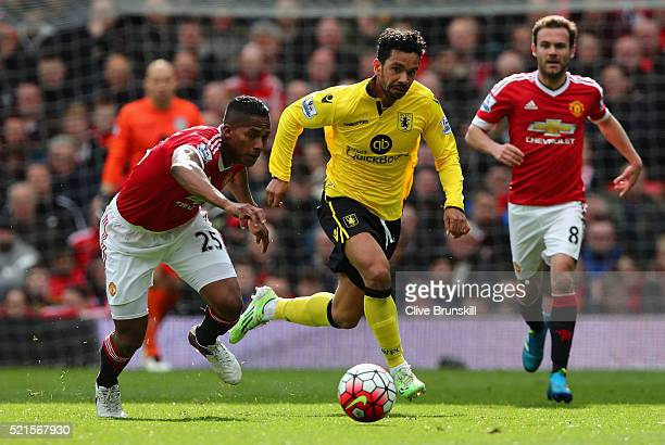 Antonio Valencia of Manchester United and Kieran Richardson of Aston Villa in action during the Barclays Premier League match between Manchester...