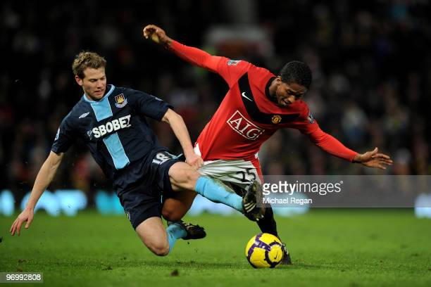 Antonio Valencia of Manchester United battles Jonathan Spector of West Ham United during the Barclays Premier League match between Manchester United...