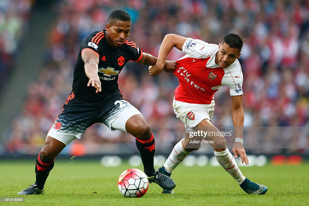 Antonio Valencia of Manchester United battles with Alexis Sanchez of Arsenal during the Barclays Premier League match between Arsenal and Manchester United at Emirates Stadium on October 4, 2015 in London, United Kingdom