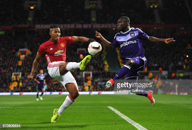 Antonio Valencia of Manchester United beats Frank Acheampong of RSC Anderlecht to the ball during the UEFA Europa League quarter final second leg...