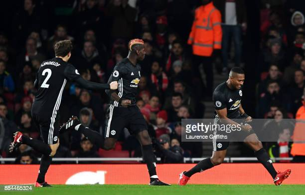 Antonio Valencia of Manchester United celebrates after scoring his sides first goal with Paul Pogba of Manchester United during the Premier League...
