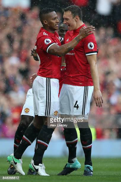 Antonio Valencia of Manchester United celebrates scoring his sides first goal with Phil Jones of Manchester United during the Premier League match...
