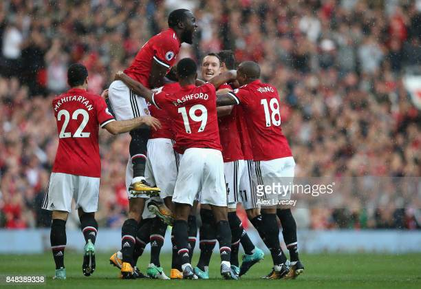 Antonio Valencia of Manchester United celebrates scoring his sides first goal with his Manchester United team mates during the Premier League match...