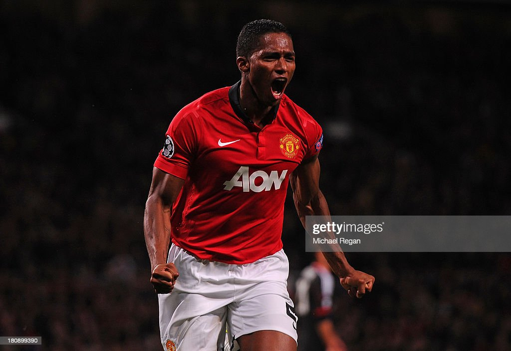 Antonio Valencia of Manchester United celebrates scoring his team's fourth goal during the UEFA Champions League Group A match between Manchester United and Bayer Leverkusen at Old Trafford on September 17, 2013 in Manchester, England.