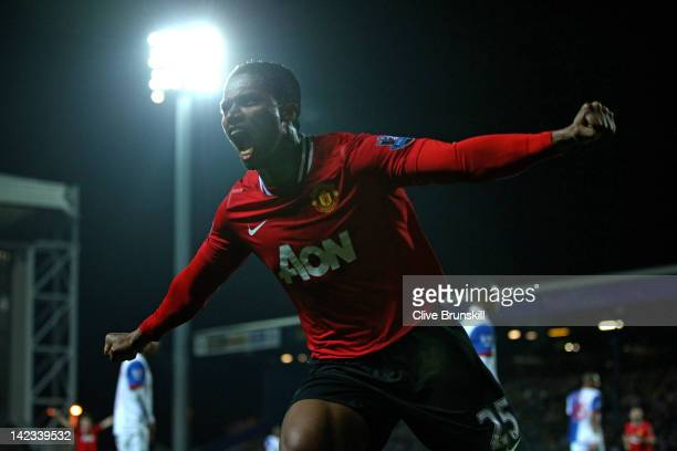 Antonio Valencia of Manchester United celebrates scoring the opening goal during the Barclays Premier League match between Blackburn Rovers and...