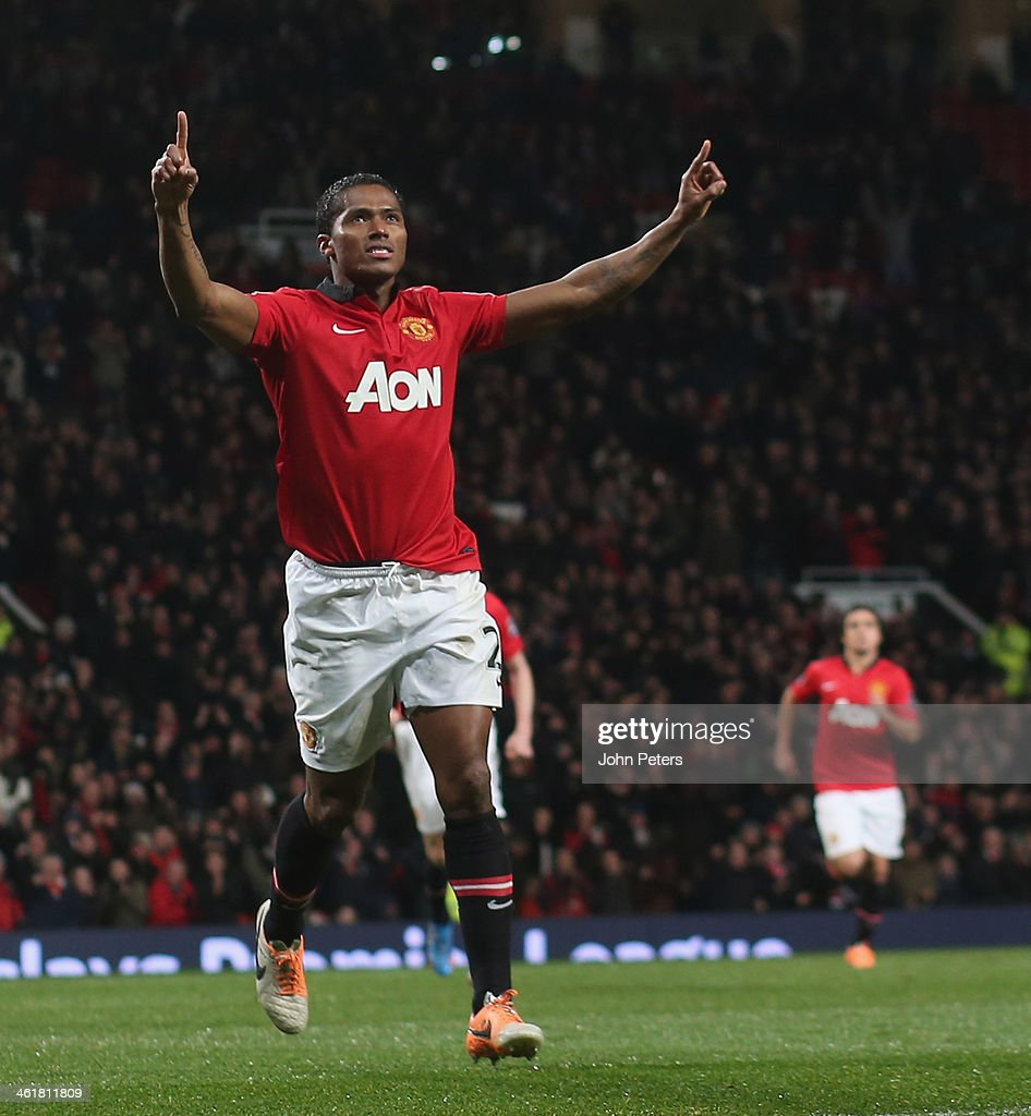 <a gi-track='captionPersonalityLinkClicked' href=/galleries/search?phrase=Antonio+Valencia&family=editorial&specificpeople=543830 ng-click='$event.stopPropagation()'>Antonio Valencia</a> of Manchester United celebrates scoring their first goal during the Barclays Premier League match between Manchester United and Swansea City at Old Trafford on January 11, 2014 in Manchester, England.