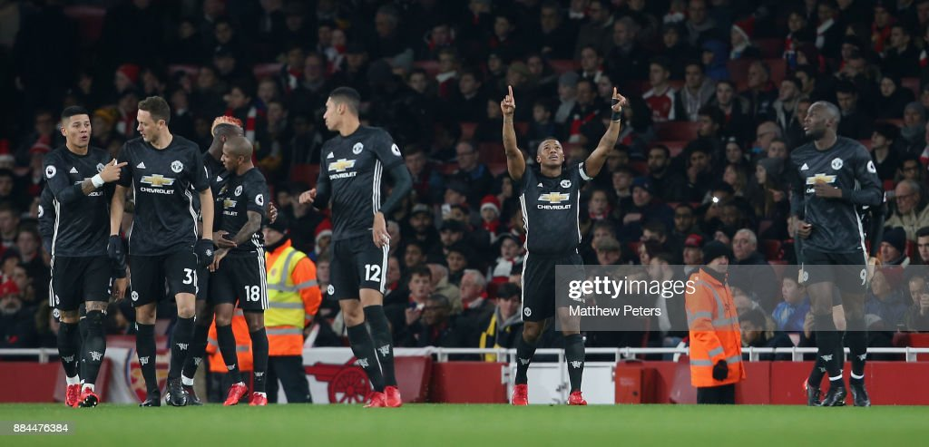 Antonio Valencia of Manchester United celebrates scoring their first goal during the Premier League match between Arsenal and Manchester United at Emirates Stadium on December 2, 2017 in London, England.