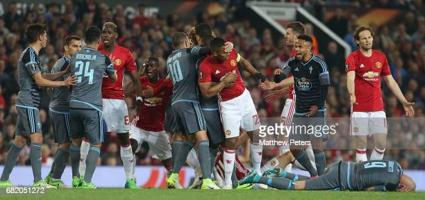 Antonio Valencia of Manchester United clashes with Iago Aspas of Celta Vigo while Paul Pogba clashes with Facundo Roncaglia during the UEFA Europa...
