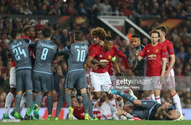Antonio Valencia of Manchester United clashes with John Guidetti of Celta Vigo while Paul Pogba clashes with Facundo Roncaglia during the UEFA Europa...