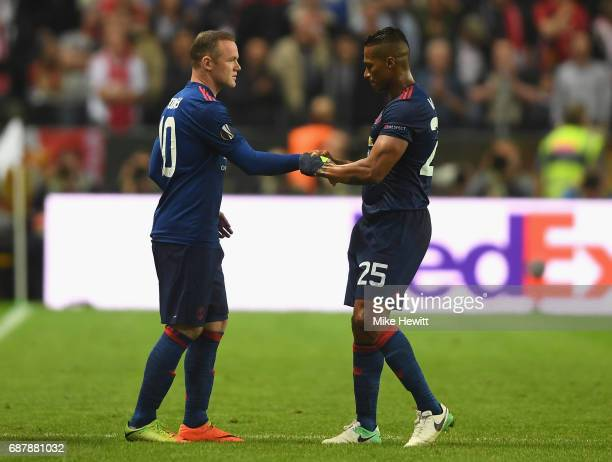 Antonio Valencia of Manchester United gives Wayne Rooney of Manchester United the captains arm band as he is subbed on during the UEFA Europa League...