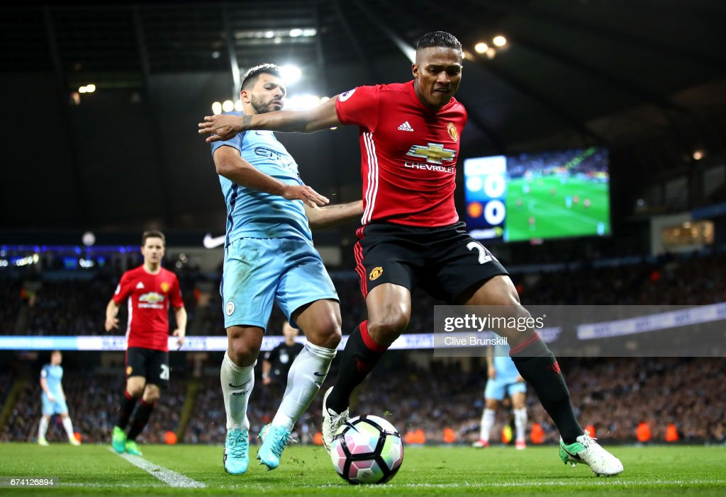 Antonio Valencia of Manchester United holds off Sergio Aguero of Manchester City during the Premier League match between Manchester City and Manchester United at Etihad Stadium on April 27, 2017 in Manchester, England.