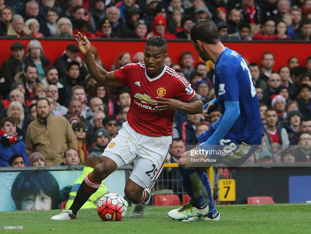 <a gi-track='captionPersonalityLinkClicked' href=/galleries/search?phrase=Antonio+Valencia&family=editorial&specificpeople=543830 ng-click='$event.stopPropagation()'>Antonio Valencia</a> of Manchester United in action with <a gi-track='captionPersonalityLinkClicked' href=/galleries/search?phrase=Christian+Fuchs&family=editorial&specificpeople=4143238 ng-click='$event.stopPropagation()'>Christian Fuchs</a> of Leicester City during the Barclays Premier League match between Manchester United and Leicester City at Old Trafford on May 1, 2016 in Manchester, England.