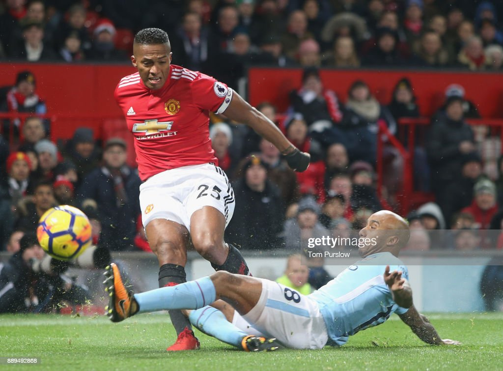 Antonio Valencia of Manchester United in action with Fabian Delph of Manchester City during the Premier League match between Manchester United and Manchester City at Old Trafford on December 10, 2017 in Manchester, England.