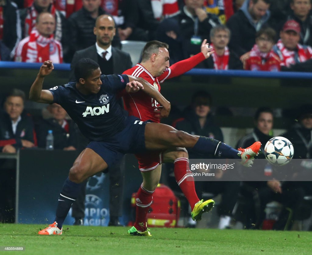 <a gi-track='captionPersonalityLinkClicked' href=/galleries/search?phrase=Antonio+Valencia&family=editorial&specificpeople=543830 ng-click='$event.stopPropagation()'>Antonio Valencia</a> of Manchester United in action with <a gi-track='captionPersonalityLinkClicked' href=/galleries/search?phrase=Franck+Ribery&family=editorial&specificpeople=490869 ng-click='$event.stopPropagation()'>Franck Ribery</a> of Bayern Munich during the UEFA Champions League quarter-final second leg match between Bayern Munich and Manchester United at Allianz Arena on April 9, 2014 in Munich, Germany.