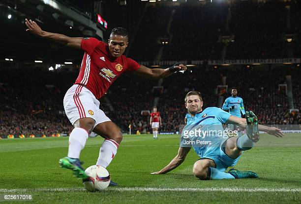 Antonio Valencia of Manchester United in action with JanArie van der Heijden of Feyenoord during the UEFA Europa League match between Manchester...