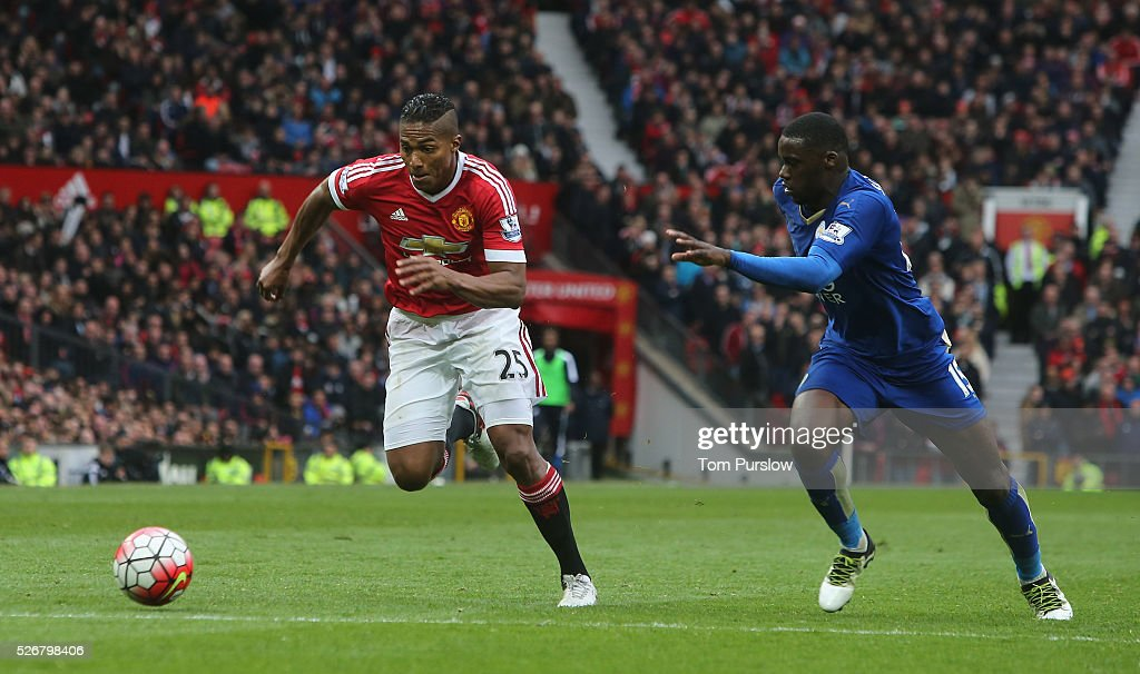 <a gi-track='captionPersonalityLinkClicked' href=/galleries/search?phrase=Antonio+Valencia&family=editorial&specificpeople=543830 ng-click='$event.stopPropagation()'>Antonio Valencia</a> of Manchester United in action with Jeffrey Schlupp of Leicester City during the Barclays Premier League match between Manchester United and Leicester City at Old Trafford on May 1, 2016 in Manchester, England.