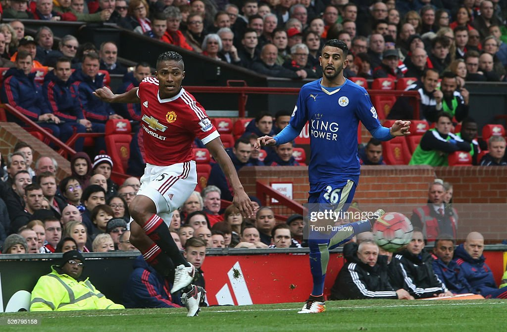 Antonio Valencia of Manchester United in action with Riyad Mahrez of Leicester City during the Barclays Premier League match between Manchester United and Leicester City at Old Trafford on May 1, 2016 in Manchester, England.