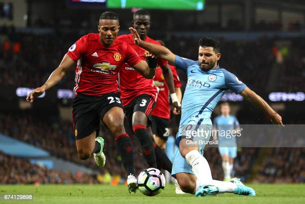 Antonio Valencia of Manchester United puts pressure on Sergio Aguero of Manchester City during the Premier League match between Manchester City and...